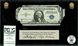 USA, $1 silver certificate, series 1935E, serial M68085473H, Priest-Humphrey, in lucite display, PCGS Currency Grade B.