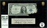 USA, $1 silver certificate, series 1935E, serial T70134255H, Priest-Humphrey, in lucite display, PCGS Currency Grade B.