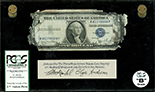 USA, $1 silver certificate, series 1935D, serial R81178009F, Clark-Snyder, in lucite display, PCGS Currency Grade B.