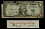 USA, $1 silver certificate, series 1935A, serial H36409238C, Julian-Morgenthau, salvaged from the Andrea Doria (1956), in large lucite capsule and original promotional case.