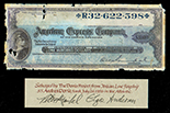 USA, American Express Company, $100 traveler's check, serial R32622598, signed by ship's passenger, salvaged from the Andrea Doria (1956), in large lucite capsule and original promotional case.