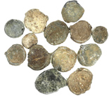 "Group of 13 small lead seals of the mid-1800s (one possibly earlier). 135 grams total, up to 7/8"" in diameter. Thick, uncleaned and encrusted disks, some with readable lettering and images, unattributable without cleaning."