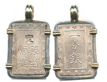 "Japan, 1 bu (ichi-bu gin, ""samurai coin""), mid-1800s, mounted in silver pendant with 14k gold prongs and bale. Popular rectangular coin (larger version) with Japanese characters (3 on one side and 5 on the other) inside borders of dots, nice XF."