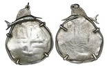 Potosi, Bolivia, cob 8 reales, Philip IV or Charles II from the pirated wreck of La Consolacion (1681), heavy wear but still visible cross details, mounted in silver bezel with dolphin or sailfish at top.