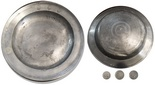"Small pewter plate, European, with hallmarks and 1804. About 9'' in diameter and 1'' tall. 1lb. Typical plate for its period with raised 1'' rim in which are stamped three very clear hallmarks (one with a coat-of-arms and the other two with H.L. above 1793), also hand-engraved in the bottom with ""No. 2"" and ""1804"" (probably made in 1793 but marked by its owner in 1804), fully intact, just with a few minor flaws as made."