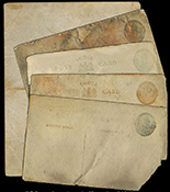 "British Indian postcards with 1/4 Anna postage stamps, ca. 1917. 3-1/2"" x 5-1/2"". Four separate postcards, preserved in laminated plastic, with light staining and degradation. Recovered from: S.S. Camberwell, sunk in 1917 off Sandown Bay, Isle of Wight, England. With original certificate from the salvager. 4 available"